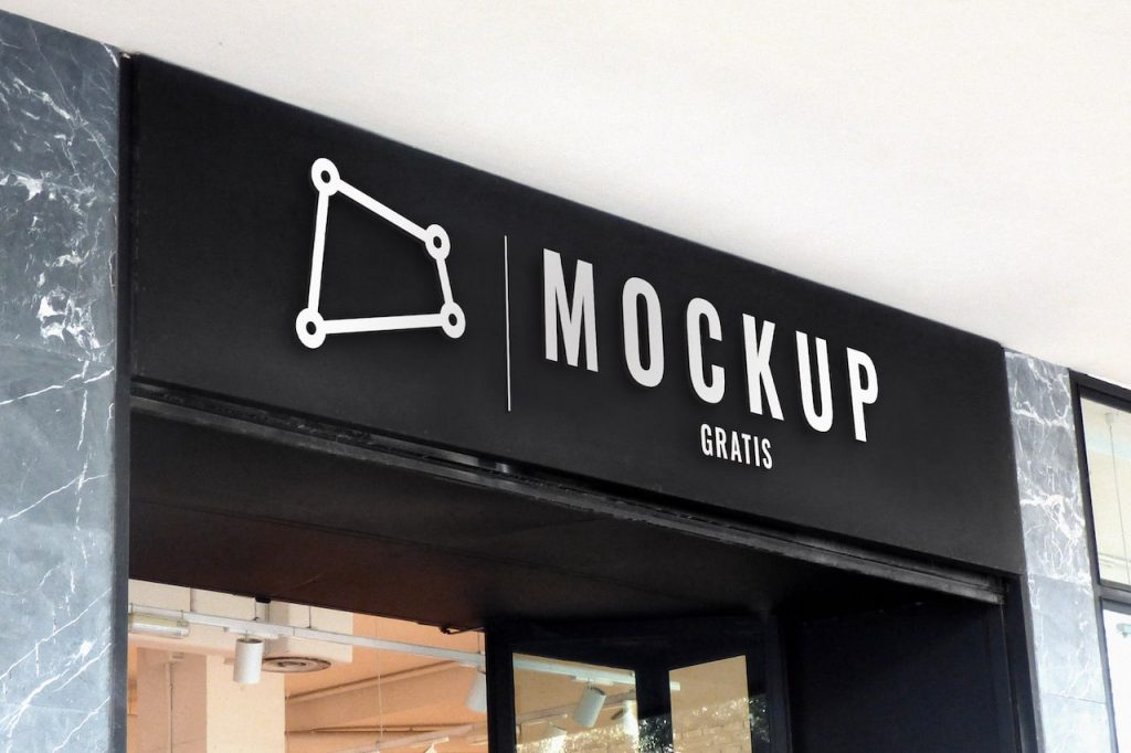 Mockup de un rótulo o letrero ubicado en el exterior de una tienda